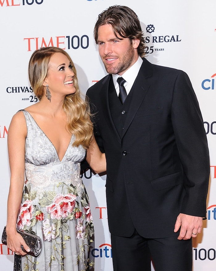 Carrie Underwood wore a floral princess gown as she walked the carpet with husband Mike Fisher at the 2014 Time 100 Gala at The Time Warner Center