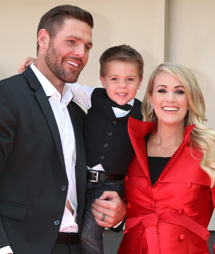 Carrie Underwood with Mike Fisher and their son Isaiah as she received her star on the Hollywood Walk of Fame