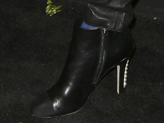 Details of Cara Delevingne's Chanel pearl-heeled cap-toe booties