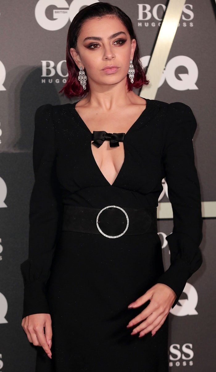 Charli XCX in a bow-embellished stretch-wool shift maxi dress from Alessandra Rich