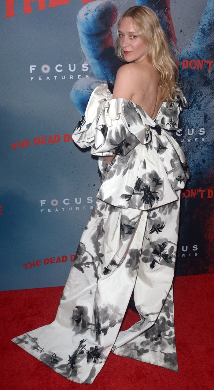 Chloe Sevigny donned a floral-print feather-detailed silk mini dress with a train