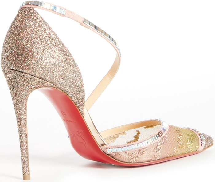 Baguette crystals wind around a sultry pointy-toe pump, highlighting the mix of materials and the curvy cross-strap of this event-ready stiletto
