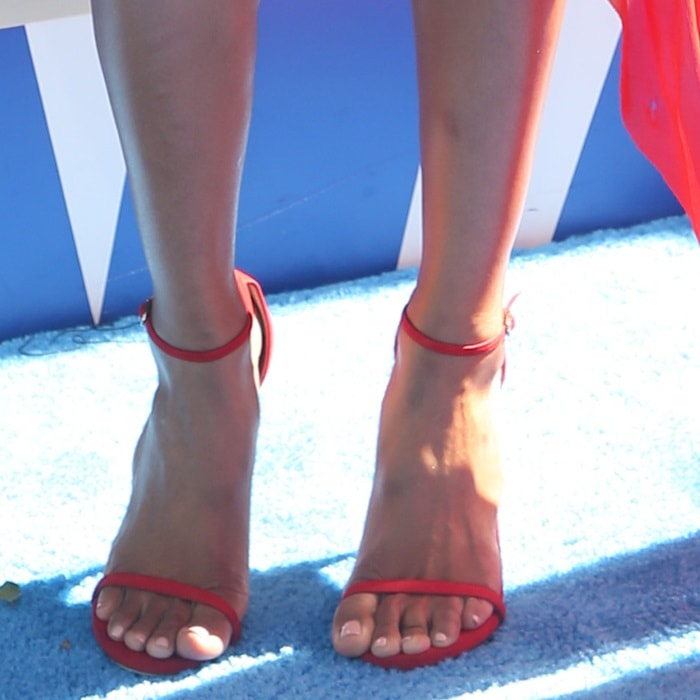 Ciara's hot feet in red Stuart Weitzman Nudist sandals