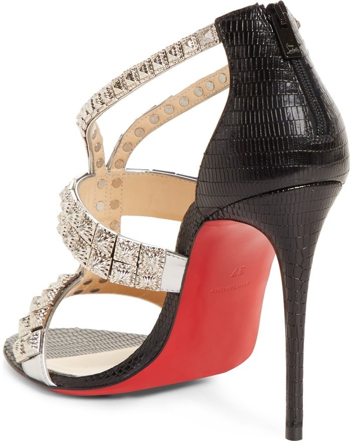 A sculptural model, it is elevated on a willowy 100mm stiletto leading up to a heel counter in black leather with an iguana motif and adjusts with a back zipper