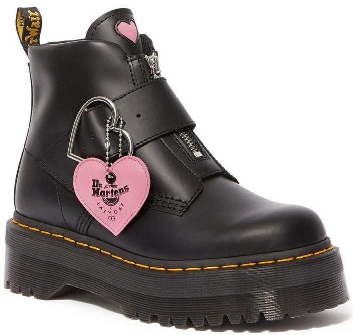 These black boots feature a statement heart shaped nickel buckle and a pink heart tag