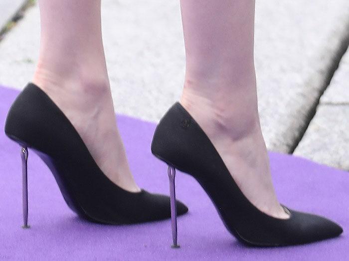 Ellie Bamber's feet in Chanel needle-heel pumps