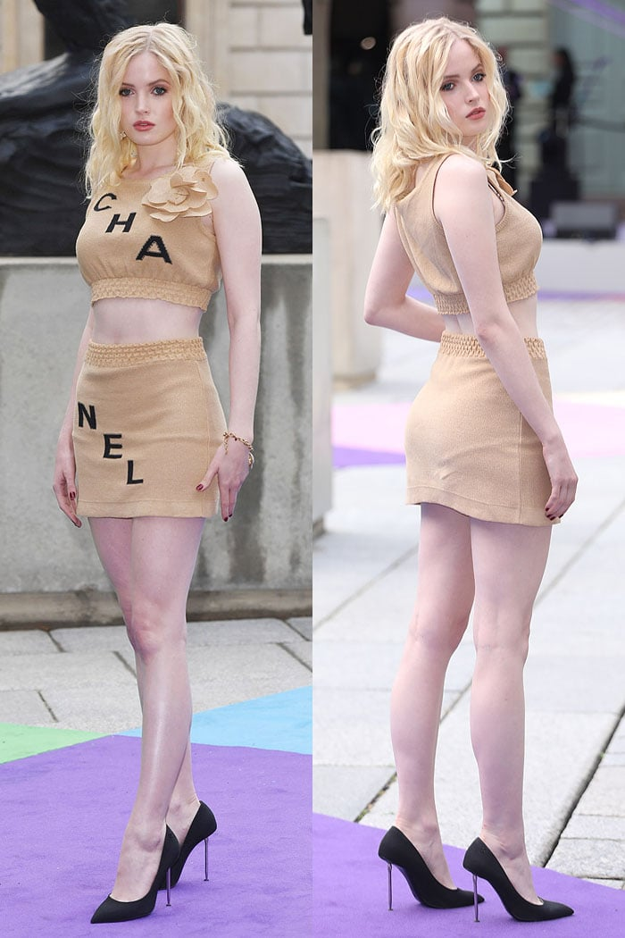Ellie Bamber flaunted her legs in a Chanel beige-and-black crop top and mini skirt