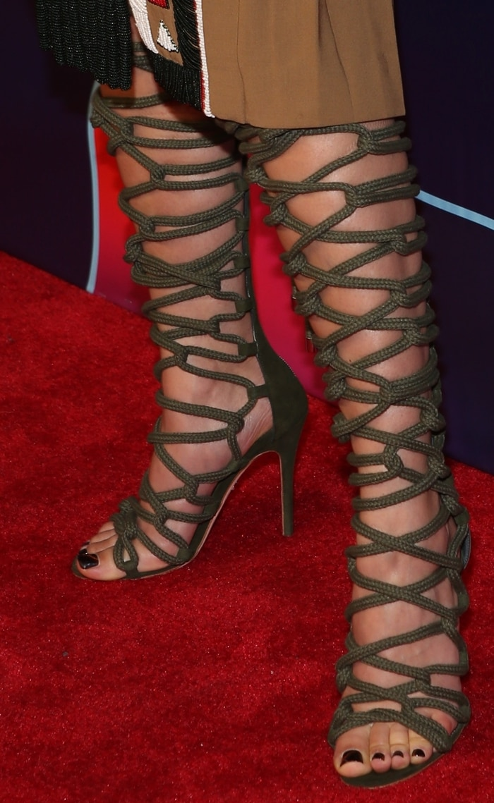 FKA Twigs showed off her feet and legs in gladiator rope sandals