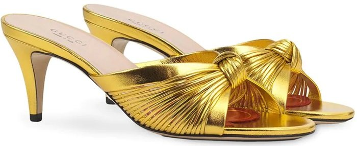 A vibrant re-imagination of a classic model, these gold-tone leather knot detail metallic sandals feature a branded insole, an open toe, a tapered mid-heel and a knotted detail to the front