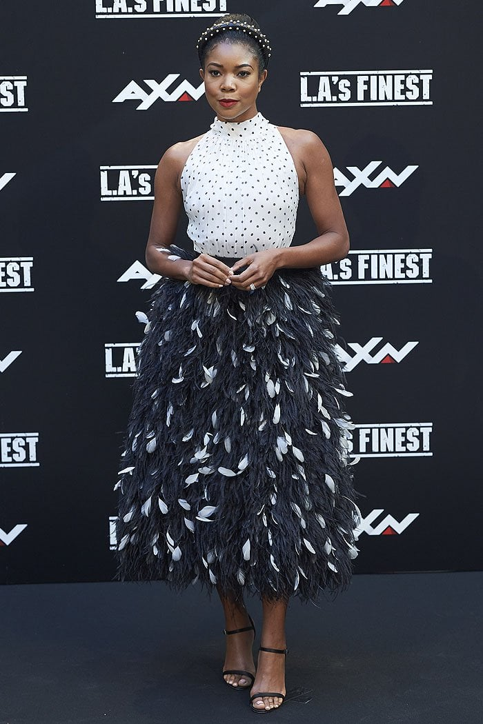Gabrielle Union in a Prada polka-dotted ostrich-feather-skirt dress and black skinny-strap sandals