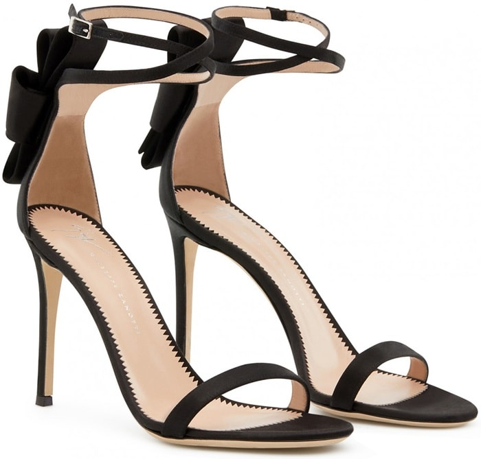 Featuring an open toe, a strappy design, a branded insole, a bow detail on the back, an ankle strap with a side buckle fastening and a high stiletto heel