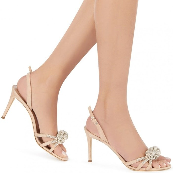 These sandals fasten with a thin ankle strap and are set on a leather logo sole