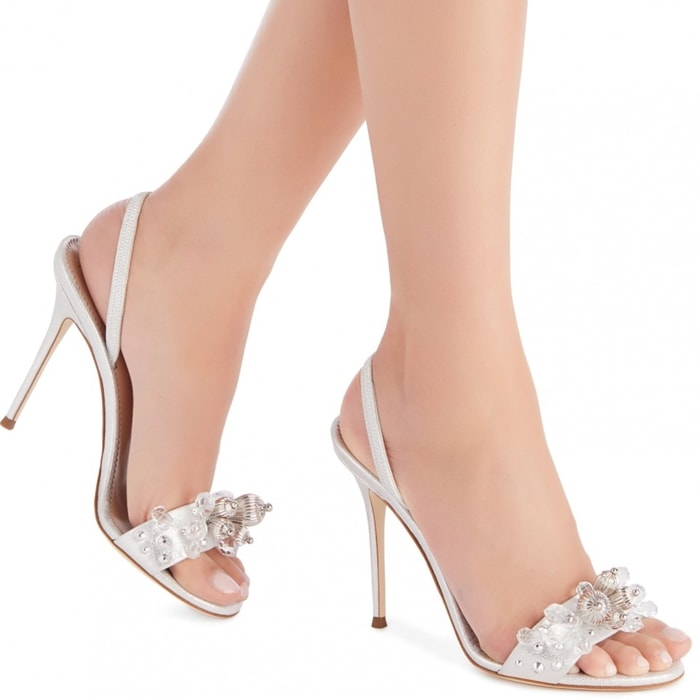 These silver sandals are adorned with pearls and crystals and detailed with the Giuseppe Zanotti logo on the leather sole