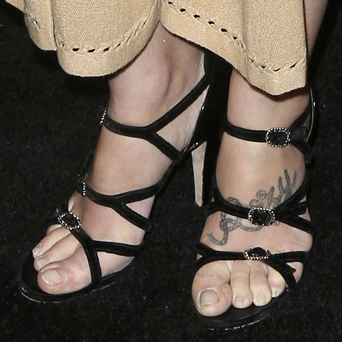 Jemima Kirke's feet in Chanel chain-buckled strappy velvet sandals with patent heels