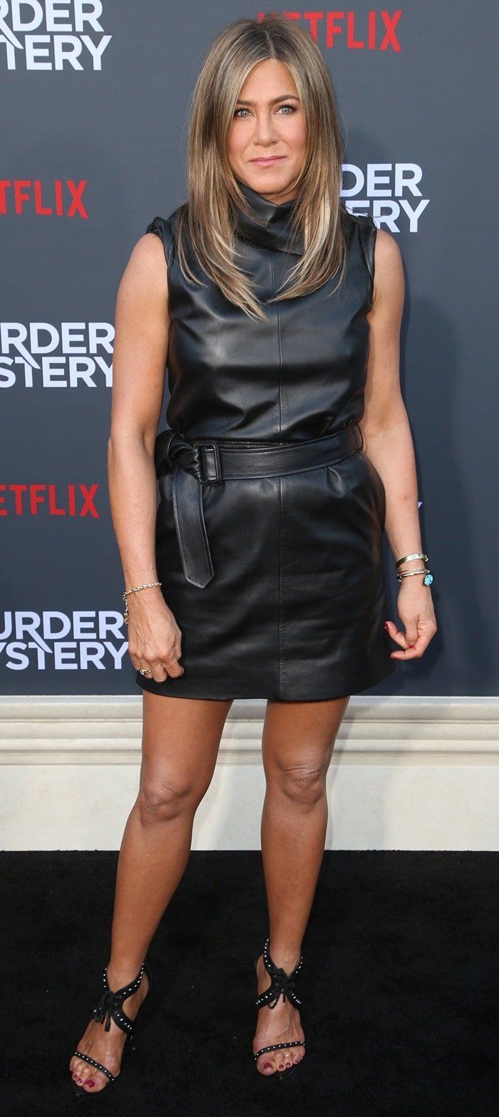 Jennifer Aniston flaunts her hot legs in a belted sleeveless Celine leather dress