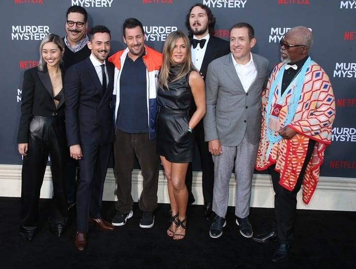 Shioli Kutsuna, Erik Griffin, Luis Gerardo Méndez, Adam Sandler, Jennifer Aniston, Kyle Newacheck, Dany Boon, and John Kani at the premiere of Murder Mystery