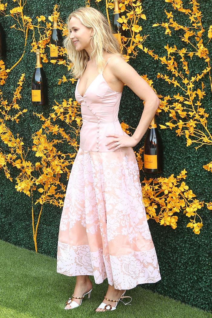 Jennifer Lawrence in a Rosie Assoulin champagne-pink silk-damask midi dress