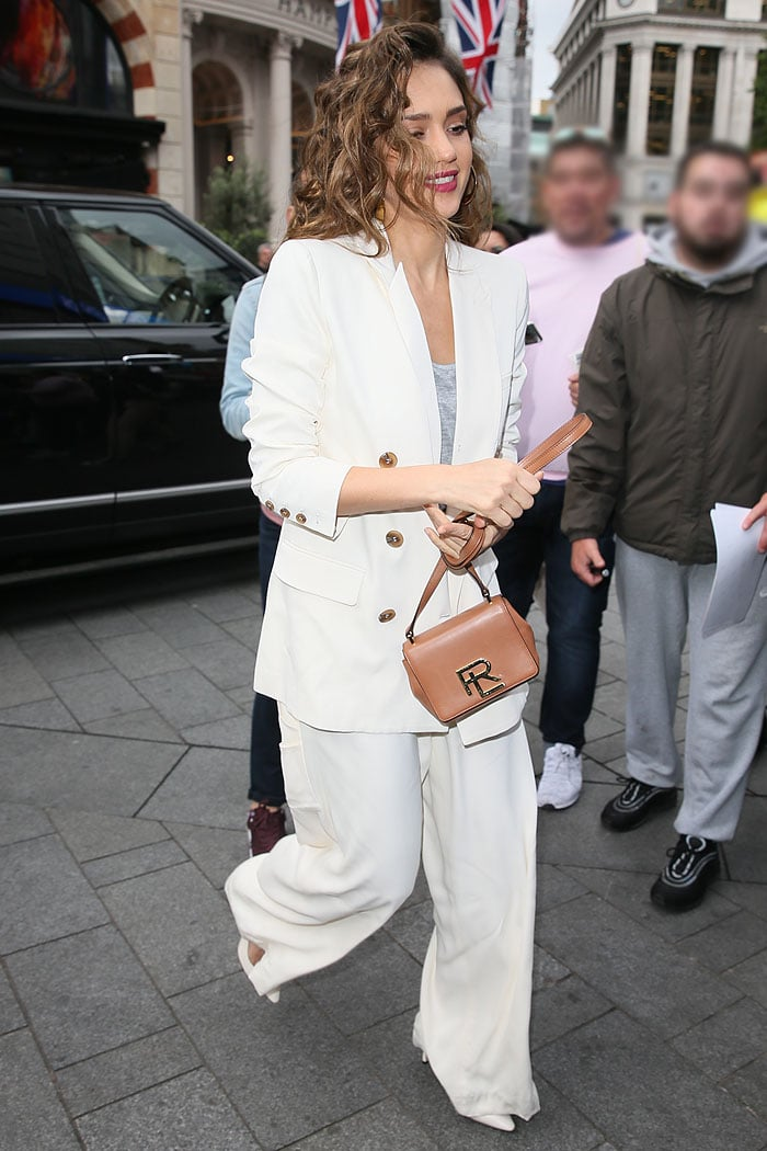 Jessica Alba in an Opening Ceremony white pantsuit and Jimmy Choo 'Erin' white slingback pumps
