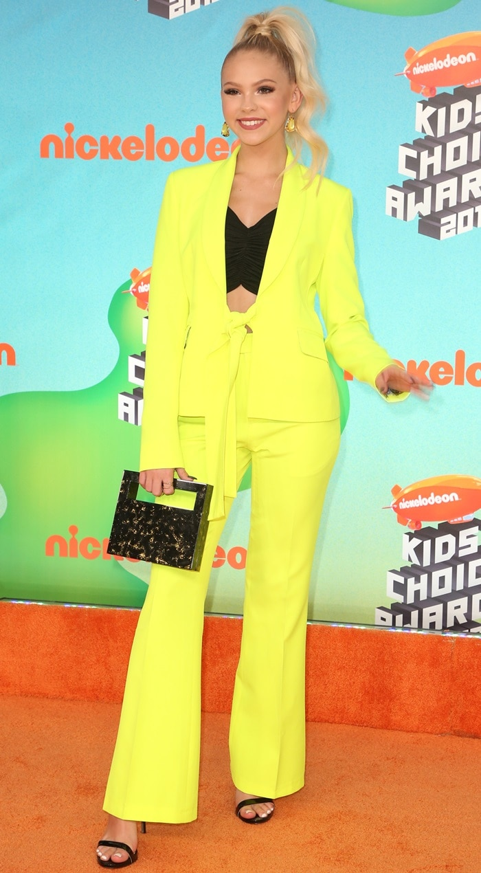 Jordyn Jones in a bright yellow suit at the 2019 Kids' Choice Awards