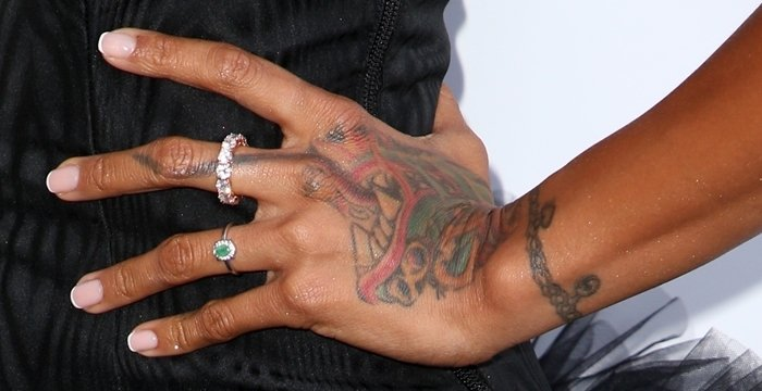 Karrueche Tran's enormous hand tattoo of a Chinese dragon