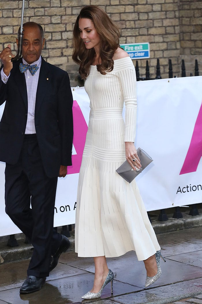 Kate Middleton in a cream off-shoulder dress and glitter pumps