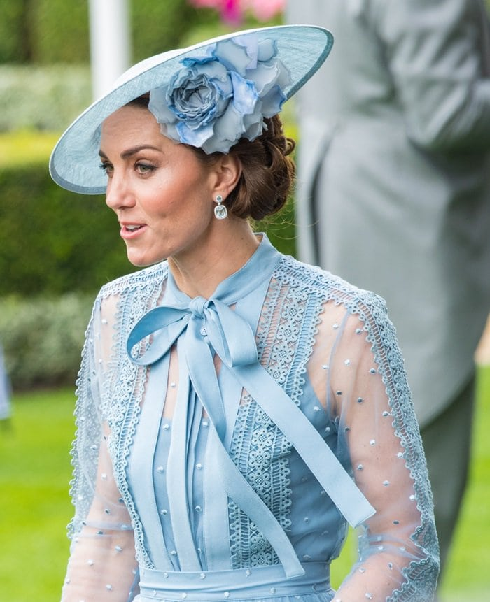 Catherine, Duchess of Cambridge styled her blue Elie Saab dress with a matching Philip Treacy hat