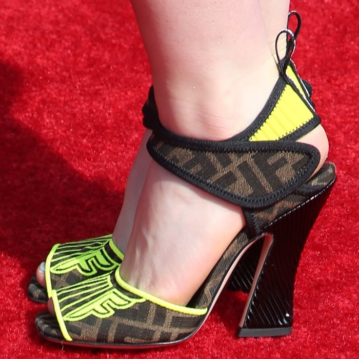 Kiernan Shipka's hot feet in FFreedom shoes made of jacquard fabric with FF motif and yellow embroidery