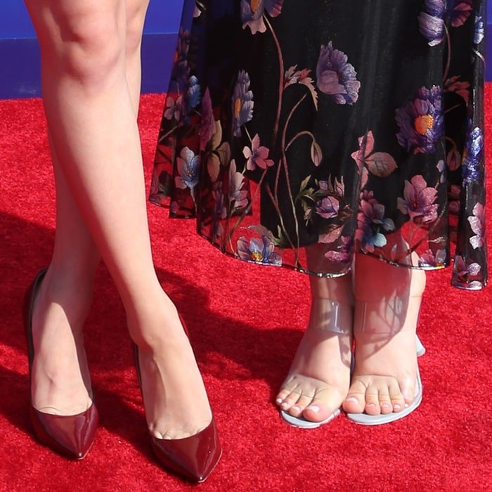 Lana Condor and Madeleine Arthur show off their sexy feet on the red carpet