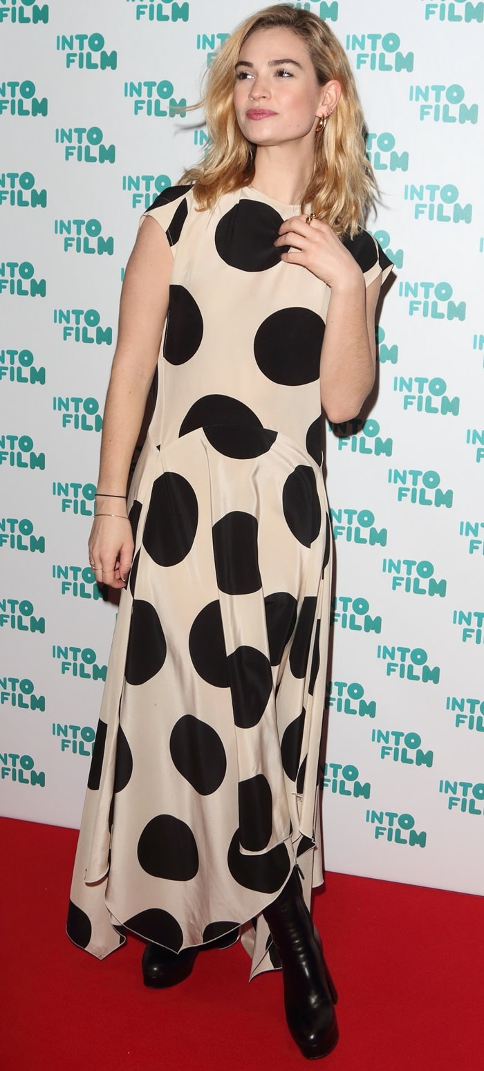 Lily James in an asymmetric polka-dot silk-crepe midi dress