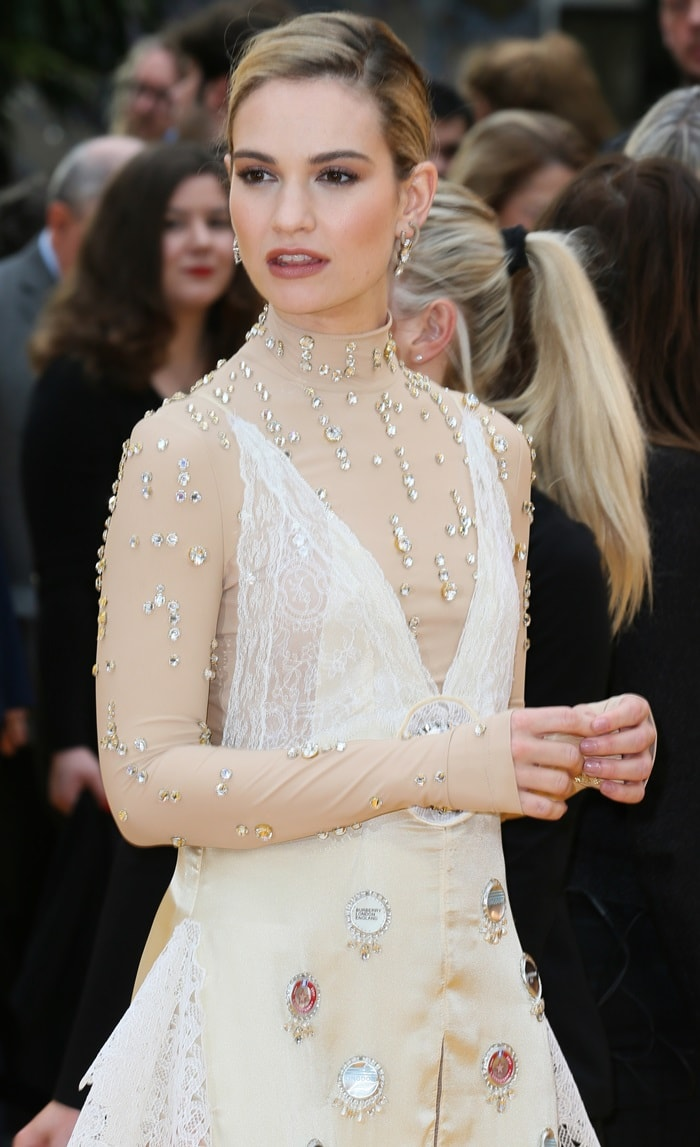Lily James wore a bedazzled lace-mesh dress adorned with bottle tops