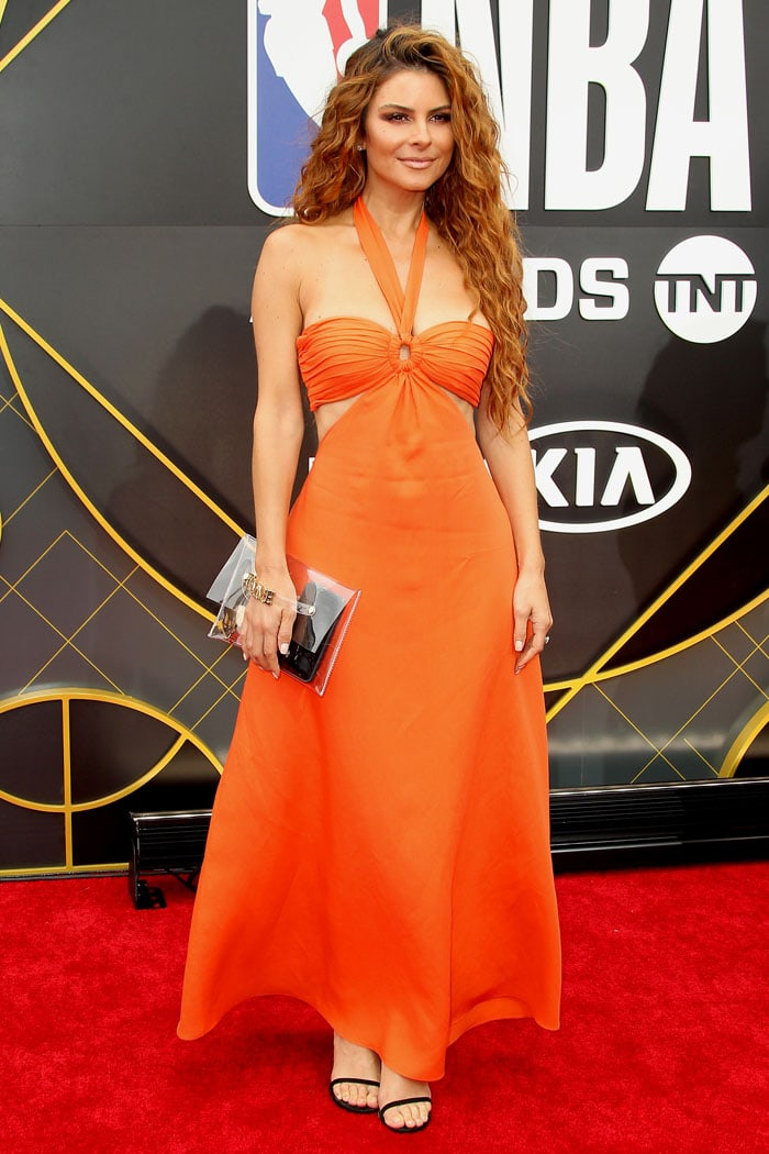 Maria Menounos in an orange halter dress at the 2019 NBA Awards