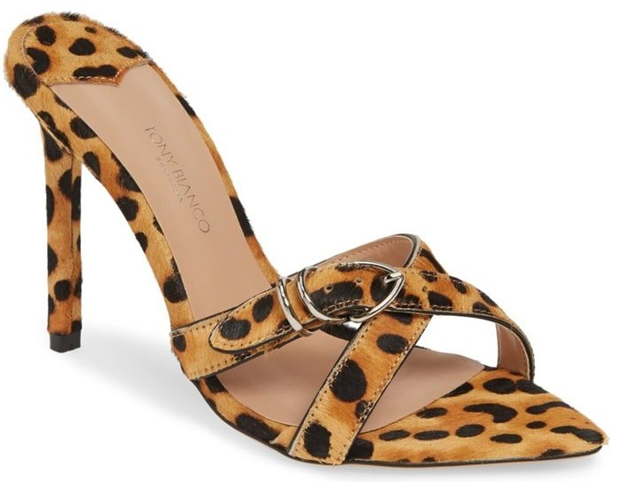 A tan leopard print pony hair Mikki stiletto heel with a pointed open toe shape with slender multiple cross over straps and adjustable ankle buckle