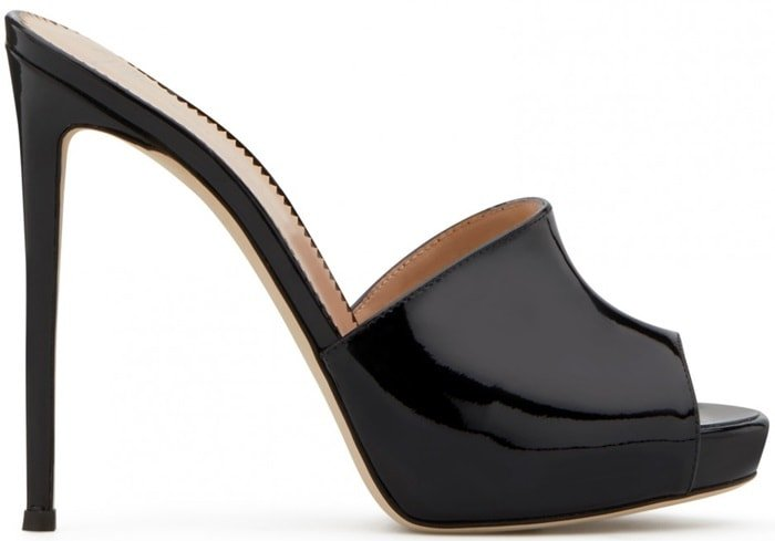 These black patent leather Nettie mules feature a peep toe, a slip-on style, a branded insole and a high stiletto heel