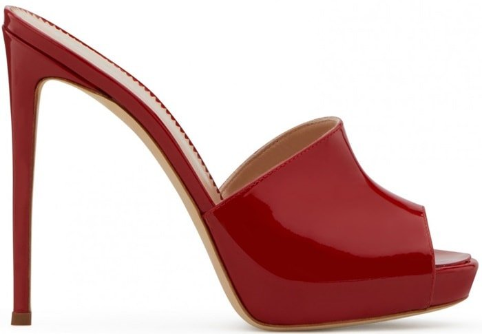 These red patent leather Nettie mules feature a peep toe, a slip-on style, a branded insole and a high stiletto heel