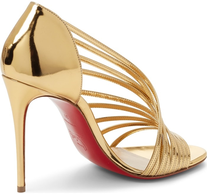 Crafted in Italy, Christian Louboutin's gold specchio leather Norina sandals feature multiple slender straps arranged in an asymmetric fan motif