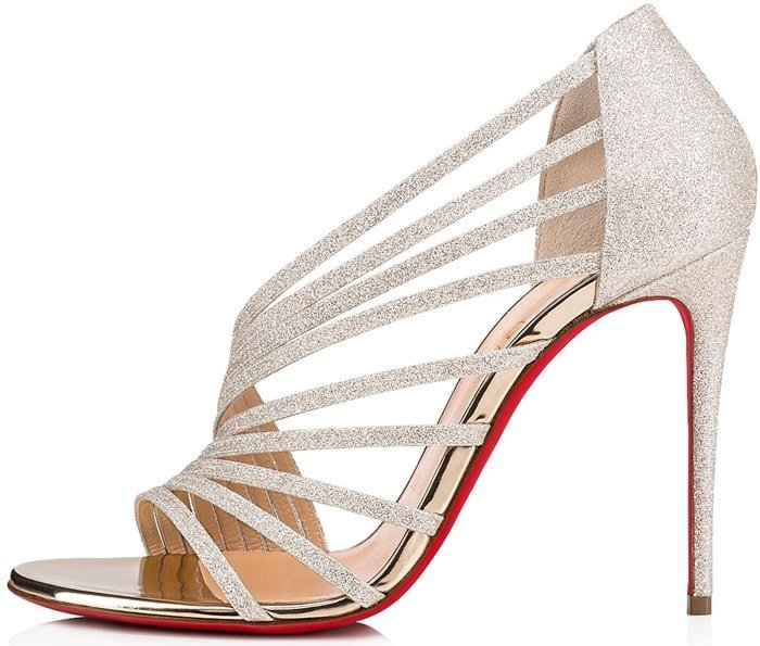 A scintillating curve of straps makes a sculptural statement on this soirée-ready stiletto sandal