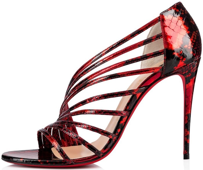 Raised on a 100mm heel, the model is crafted in liquid-sleek red and black snakeskin, like a gloss for the lips