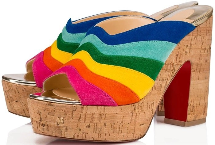 Live life in technicolor in these scalloped rainbow platform mules that are offset with metallic and cork accents