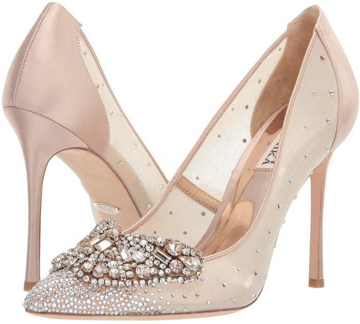 Dazzling placed crystals ornament the pointed toe and pepper the curved sides of a party-ready pump in lustrous satin and breezy mesh