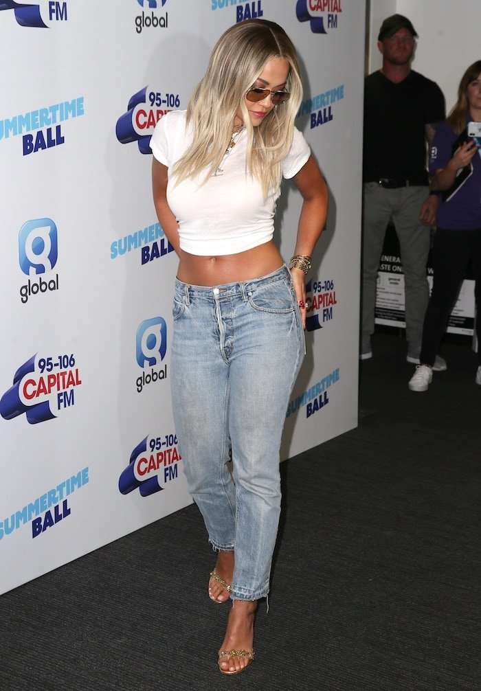 Rita Ora flashed her belly button in cropped Helmut Lang jeans and a white crop top