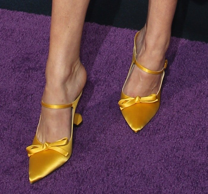 Rowan Blanchard finished her look with yellow structured heel satin pumps from Prada/