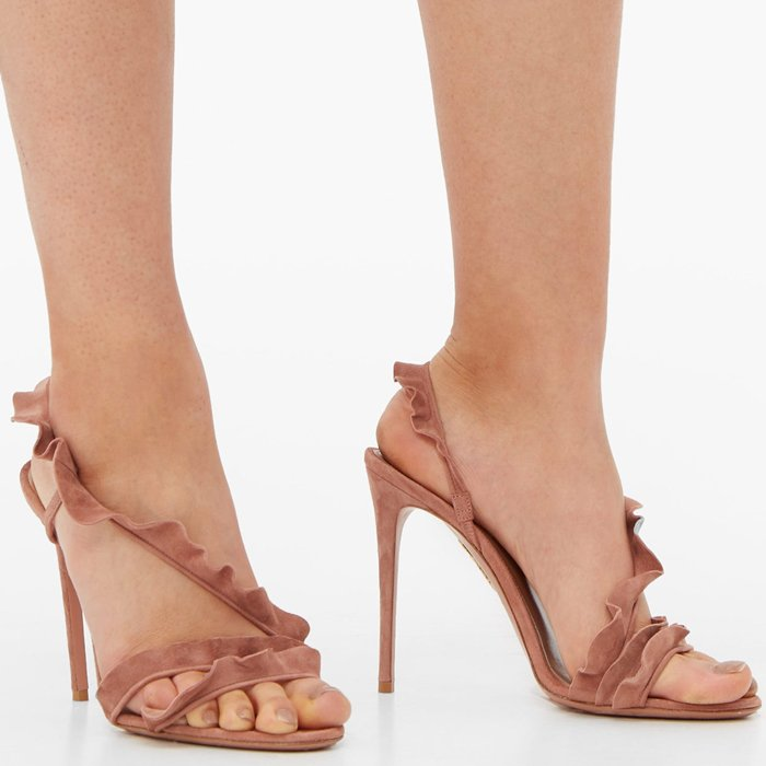 Made in Italy from buttery suede in blush powder rose, the strappy style features a flirty ruffle that cascades up the foot and wraps around the ankle