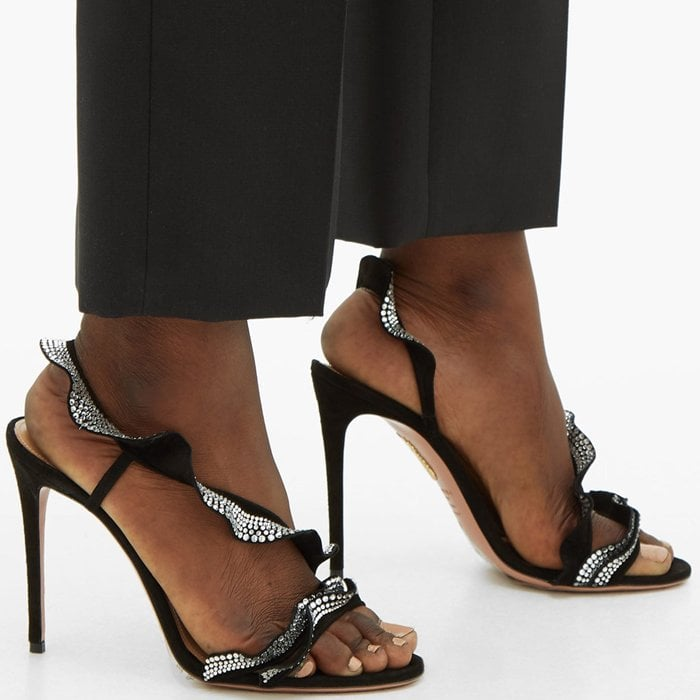 These black statement sandals are named Ruffle after the frothy straps that splice across the arch and segue into a slingback strap