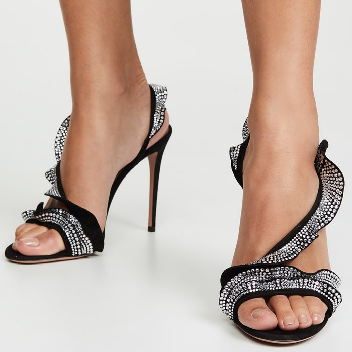 These black sandals are made from supple suede and adorned with crystals and set on a towering stiletto heel for sparkling, leg-lengthening appeal.