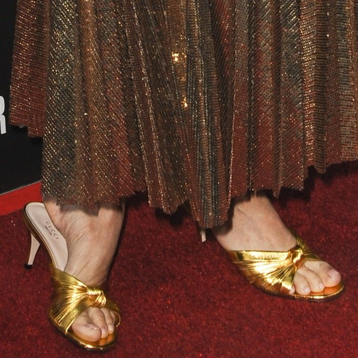 Sienna Miller's hot feet in knot detail metallic sandals from Gucci