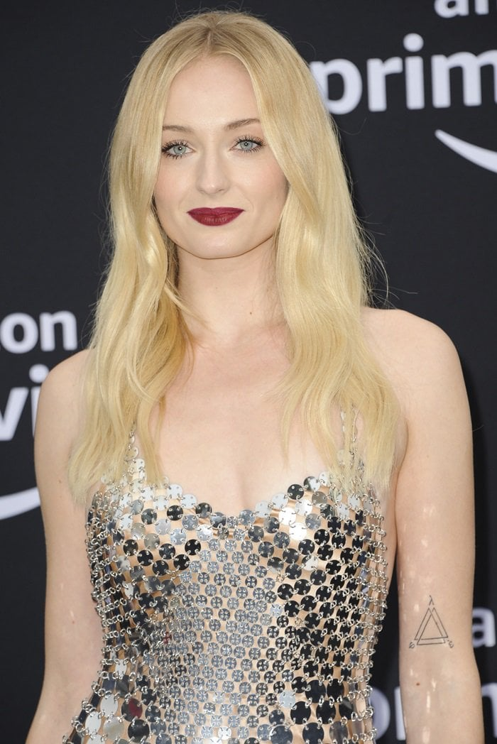 Sophie Turner had an infinite triangle tattooed on her upper left arm in July 2018