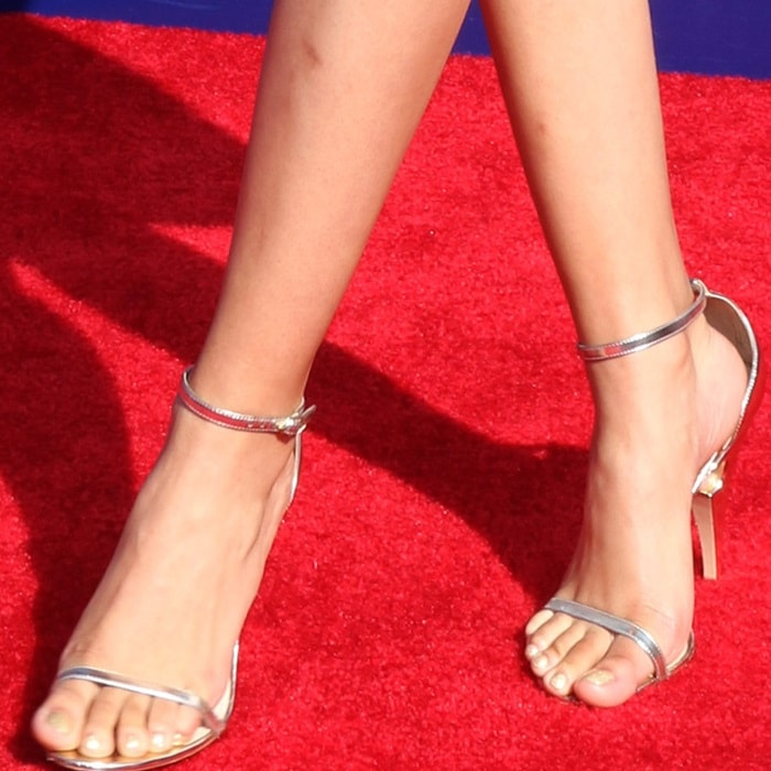 Storm Reid's pretty feet in barely-there sandals