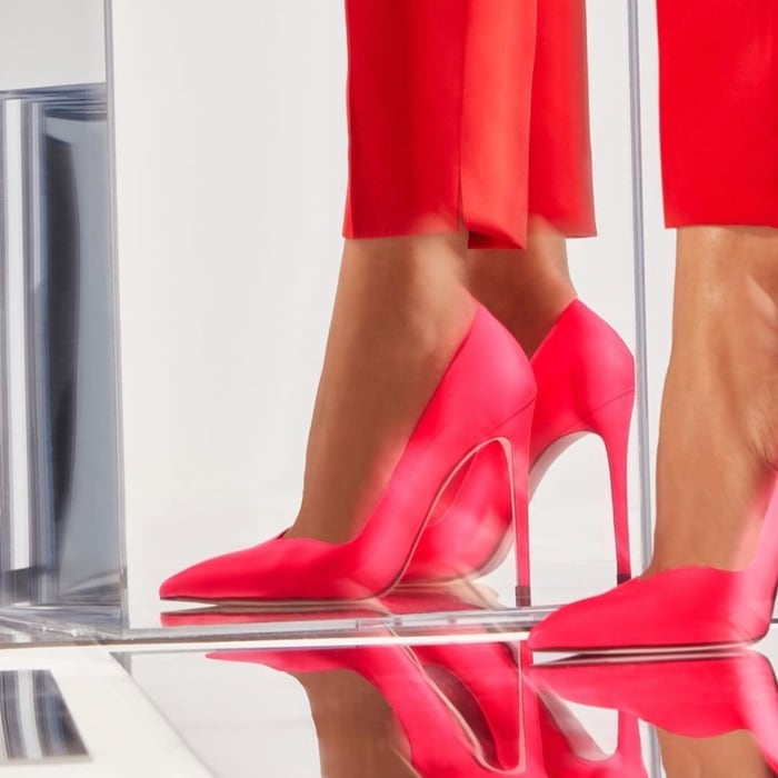 Feminine curves define these colorful stiletto pumps in neon pink