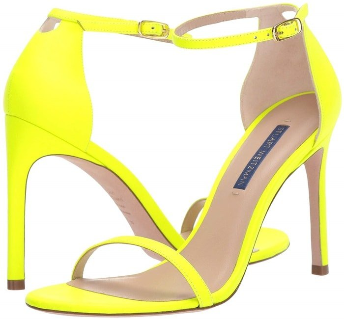 Designed to lengthen legs and turn heads, these neon sandals are crafted with a single strap across the toe and the ankle