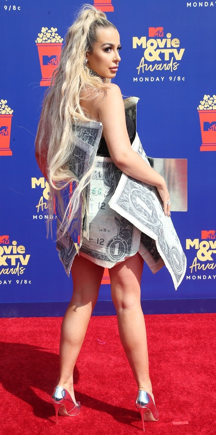Tana Mongeau flaunted her legs in silver pumps